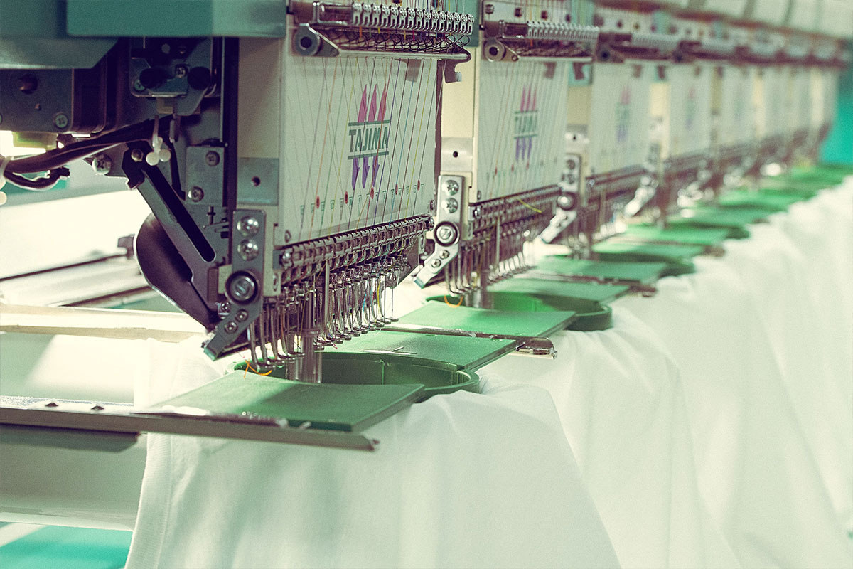 Garment finishing for custom printed and embroidered clothing and merchandise.