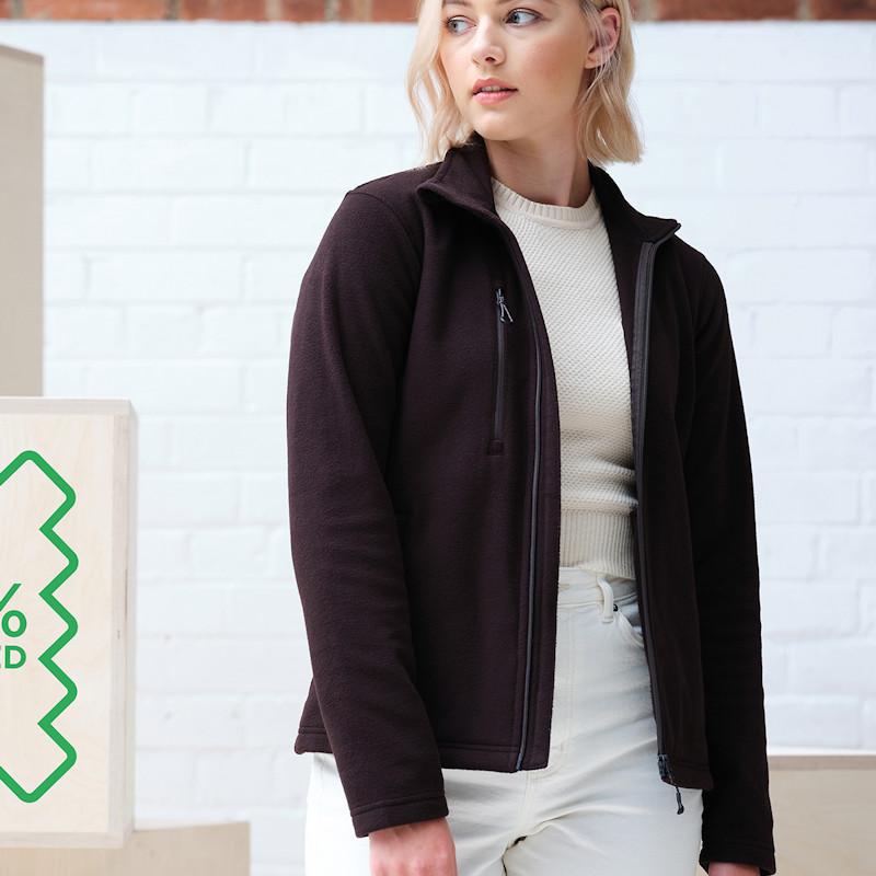 Studio shot of a woman in a Regatta Honestly Made TRF628 Women's Full Zip Fleece.